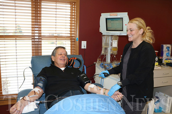 SHERRY VAN ARSDALL | THE GOSHEN NEWS<br /> At left, Lowell Nafziger of Goshen donates platelets at the American Red Cross Blood Donation Center, 1123 S. Indiana Ave., Goshen. At right, Ann Swartz-Peshel, a technician, keeps track of Nafziger's vital signs during the two-hour donation process.