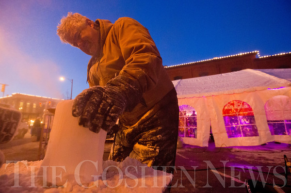 JAY YOUNG | THE GOSHEN NEWS<br /> Greg Beachey carves a beer mug out of ice during January's First Friday Fire and Ice event. Earlier in the day, Beachey helped carve an ice bar that was used during the event.