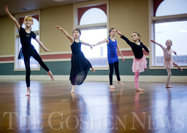 JAY YOUNG | THE GOSHEN NEWS<br /> From left, Raegan Paxton, Lydia Bergdall, Bindi Kamp, Magdalena Hurst and Elliott Carl practice a few dance moves during the first day of a youth dance class hosted by the Goshen Department of Parks and Recreation on Tuesday afternoon at the Goshen Theater. Tuesday marked the first day of classes for the six to eight-year-olds. The classes will run for the next 16 weeks, cumulating with a dance show on May 6 at the Goshen High School auditorium that will feature over 100 dancers.