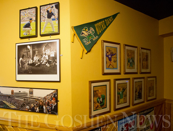 JAY YOUNG | THE GOSHEN NEWS<br /> Sports memorabilia lines the walls of the new Craft Burger and Brew restaurant in Elkhart.  The new establishment is taking the place of the old Between the Buns Bar and Grill.