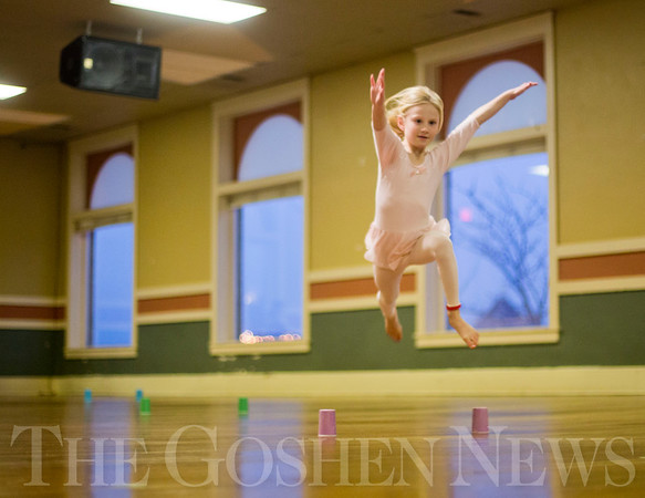 JAY YOUNG | THE GOSHEN NEWS<br /> Six-year-old Elliott Carl leaps through the air over an imaginary fence during a youth dance class hosted by the Goshen Department of Parks and Recreation on Tuesday afternoon at the Goshen Theater. Tuesday marked the first day of classes for the six to eight-year-olds. The classes, taught by dance instructor Tricia Blosser, run for the next 16 weeks, cumulating with a dance show on May 6 at the Goshen High School auditorium that will feature over 100 dancers.