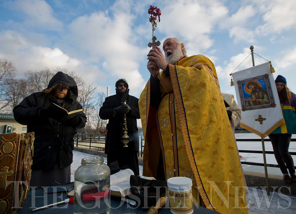 JAY YOUNG | THE GOSHEN NEWS<br /> Father Matthew Wade of St. Mary's Orthodox Church leads a Blessing of the Waters ceremony at Goshen Dam Pond Friday afternoon.