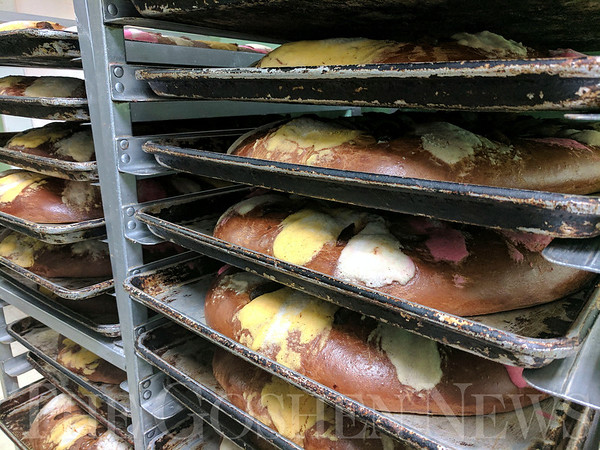 SHEILA SELMAN | THE GOSHEN NEWS<br /> Rosca de Reyes cakes wait to be boxed for sale today as Gutierrez Mexican Baker customers celebrate Three Kings Day.