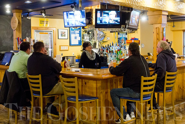 JAY YOUNG | THE GOSHEN NEWS<br /> Craft Burger and Brew daytime bartender Katie Hawkins talks to patrons seated around the bar on Tuesday afternoon.