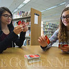 "JAY YOUNG | THE GOSHEN NEWS<br /> Madison Miller, right, smiles as she draws a card while Alissa Beatriz looks over the cards in her hand as the two play UNO at the Goshen Public Library on Thursday after school. Miller said that Beatriz always wins when the two play. Beatriz responded by saying with a laugh that Miller ""is just really bad at it."" Each Thursday during the school year, the library host Teen Café from 4 p.m. until 6 p.m. Teen Coordinator Emily Stuckey Weber said the Teen Café is a gathering where teens can hang out after school, play games and have drinks such as hot chocolate or coffee. Other teen programs at the library for January include Crafty Bandits on Jan. 10 from 4 p.m. until 6 p.m. where teens will be making accordion books. On Jan. 17 from 4 p.m. to 6 p.m. the library will host Smoothies and Sushi where teens will learn how to make tasty snacks. Also, on Jan. 27 from 6 p.m. until 8 p.m. the library will transform into a mini golf course for its afterhours teen program, Nerd's Night Out."