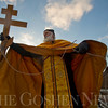 JAY YOUNG | THE GOSHEN NEWS<br /> Father Matthew Wade of St. Mary's Orthodox Church looks back as he heaves a wooden cross into the Goshen Dam Pond Friday afternoon during a Blessing of the Waters ceremony.