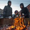 JAY YOUNG | THE GOSHEN NEWS<br /> Three-year-old Kavion Messick roasts marshmallows with his grandparents, Steve and Christine Messick, all of Goshen,  during January's First Friday Fire and Ice event.