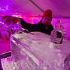 JAY YOUNG | THE GOSHEN NEWS<br /> Brad Hunsburger pours a bottle of liquor through the luge frozen into the center of an ice bar at January's First Friday Fire and Ice event.