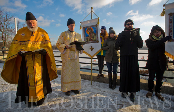 JAY YOUNG | THE GOSHEN NEWS<br /> Father Matthew Wade of St. Mary's Orthodox Church leads of Blessing of the Waters ceremony at the Goshen Dam Pond on Friday afternoon.