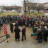 JAY YOUNG | THE GOSHEN NEWS<br /> A large group gathers for a prayer gathering on the lawn of the Elkhart County Courthouse in downtown Goshen on Friday afternoon. The event, which was organized by Elkhart County HOPE (Helping Our People Everywhere), was scheduled to coincide exactly with the time that Donald J. Trump was sworn in as the nation's 45th president. At the event, members of the community offered prayers and songs aimed at bringing everyone together and offering hope for all.