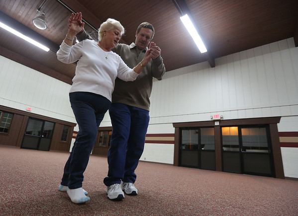 "JAY YOUNG | THE GOSHEN NEWS<br /> Ken Dixon and Lee Morgan, both of South Bend, practice a dance called the El Paso Tuesday evening at the Schrock Pavilion in Shanklin Park. The pair was recently engaged and practicing for their upcoming wedding in August. Morgan joked that when they started 10 weeks ago, Dixon ""had three left feet, but now he only has one and a half."""