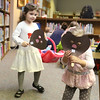 JAY YOUNG | THE GOSHEN NEWS<br /> Two-year-old Penelope Garber looks through a groundhog mask she made while her sister Josephine, 4, both of Goshen,  watches on Wednesday morning at the Goshen Public Library. This theme of this week's Children's Storytime was Groundhog Day. The children learned about groundhogs, Groundhog Day and then made groundhog masks.