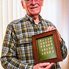 JAY YOUNG | THE GOSHEN NEWS<br /> Joe McCorkel has donated blood for the 200th time, giving 25 gallons of blood. Here he is pictured with is framed 25 pins, one for each gallon of blood donated.