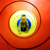 JAY YOUNG | THE GOSHEN NEWS<br /> Three-year-old Zaveah Borzenatow, of Goshen, pretends to be a groundhog as she carefully crawls through a rainbow colored tunnel Wednesday morning at the Goshen Public Library. This theme of this week's Children's Storytime was Groundhog Day. The children learned about groundhogs, Groundhog Day and then made groundhog masks.