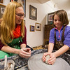 JAY YOUNG | THE GOSHEN NEWS<br /> Kristen O'Dell helps seven-year-old Lily Lovely, both of Goshen, make a pot inside of Tavi Studio and Gallery during First Friday's on Friday evening.