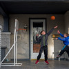JAY YOUNG | THE GOSHEN NEWS<br /> Below freezing temperatures did  not stop brothers Levi, left, and Jesse Sawatzky, 7, from playing a game of one-on-one on the porch of their home on Fifth Street in Goshen on Thursday afternoon. The National Weather service says the bitterly cold temperatures will continue Friday, with a predicted high of only 24 degrees.  The weekend looks to be warmer, however, with forecasted highs of 31 degrees on Saturday and 39 degrees on Sunday. No rain or snow is expected through Sunday.