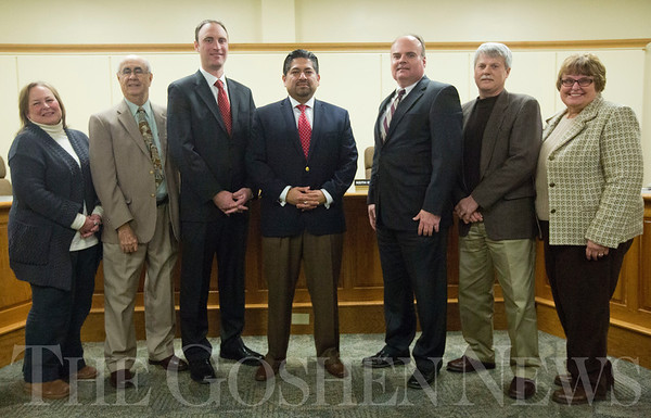JAY YOUNG | THE GOSHEN NEWS<br /> Goshen school board members, from left, Jane Troup, Jose Ortiz, Bradd Weddell, Felipe Merino, Keith Goodman, Roger Nafziger and Jane DeVoe.