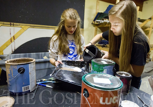 JAY YOUNG | THE GOSHEN NEWS<br /> Bethany Christian freshmen Sasha Dyck, left, and Jadyn Kaufmann prepare paint during their Technical Theater class on Wednesday morning. Students in the class are building a set for their spring production.