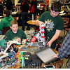 JOHN KLINE | THE GOSHEN NEWS<br /> Wawasee Middle School robotics students Hudson Bonner, left, and Wesley Hays, right, put some finishing touches on their team's robot during the Iron Pride Starstruck Blended Spring Robotics Qualifier Tournament at the middle school Saturday afternoon.