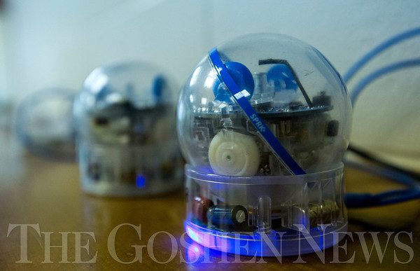 JAY YOUNG | THE GOSHEN NEWS<br /> A Sphero robot sits on its charging dock Wednesday morning at Bethany Christian. Students in the Robotic Art class are learning how to write code to control the robots' movements.