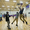 JAY YOUNG | THE GOSHEN NEWS<br /> Fourth grade student Javeis Hines, right, goes in for a shot while third grade student TreVaun Ulmer, center, plays defense and fifth grade student Tony Dukes waits for the rebound as the three play basketball Monday afternoon at the Tolson Center in Elkhart.