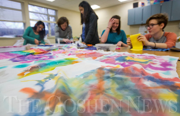 JAY YOUNG | THE GOSHEN NEWS<br /> A rainbow of colorful fabrics line a desk Tuesday afternoon at Bethany Christian while students learn about batik dying.