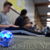 JAY YOUNG | THE GOSHEN NEWS<br /> Bethany Christian students in the Robotic Art class sit in a hallway as they work on programming their Sphero robots on Wednesday morning.