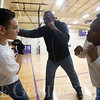 JAY YOUNG | THE GOSHEN NEWS<br /> Professional boxer James Shorter, center, teaches dodging Monday afternoon at the Tolson Center in Elkhart. Shorter is teaching youth boxing classes on Tuesdays and Thursdays at the center from 4 p.m. until 5 p.m.