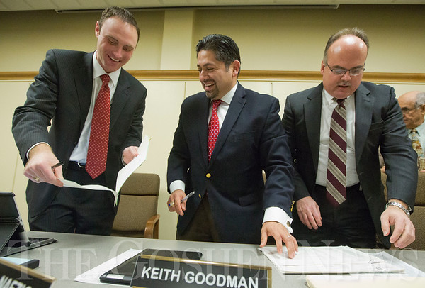 JAY YOUNG | THE GOSHEN NEWS<br /> Newly elected school board members Bradd Weddell, left, and Felipe Merino share a laugh while Keith Goodman looks over paperwork following the first board meeting of 2017. At the meeting, Merino was named the president, Weddell the vice president and Goodman the secretary.