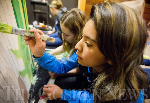 JAY YOUNG | THE GOSHEN NEWS<br /> Bethany Christian freshman Ana King paints grass on the stage during her Technical Theater class on Wednesday morning. Students in the class are building a set for their spring production.
