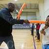 JAY YOUNG | THE GOSHEN NEWS<br /> Professional boxer James Shorter works with fourth grade student Booker Jenkins on dodging on Monday afternoon at the Tolson Center in Elkhart. Shorter is teaching youth boxing classes on Tuesdays and Thursdays at the center from 4 p.m. until 5 p.m.