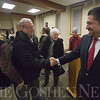 JAY YOUNG | THE GOSHEN NEWS<br /> Newly elected school board president Felipe Merino shakes hands with former board member Dwight Grieser, of Goshen, following the first board meeting of 2017. At the meeting, Merino was named the president of the board.