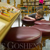JAY YOUNG | THE GOSHEN NEWS<br /> Ten-year-old Aydin Smuts, of Goshen, searches high and low in the children's section of the Goshen Public Library for a hidden snowman on Monday afternoon. On Monday, the children's department kicked off its winter reading games program. Each day until February 28, a snowman will be hidden in the children's area of the library. Children who find the snowman are entered into a drawing to win the snowman. Also, a bingo-like reading game is available where players fill up the board by reading books in different categories. Each time a bingo is made, the player is entered into a drawing for a winter goodie basket, including books and hot chocolate.