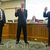 JAY YOUNG | THE GOSHEN NEWS<br /> Newly elected school board members, from left, Keith Goodman, Bradd Weddell and Felipe Merino raise their right hands as they are sworn in at the beginning of the first school board meeting of 2017 on Monday evening.