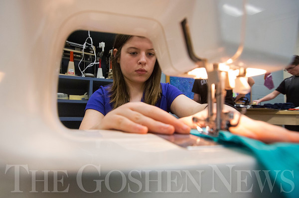 JAY YOUNG | THE GOSHEN NEWS<br /> Bethany Christian sixth grade student Julia Moser concentrates carefully while using a sewing machine Tuesday afternoon at Bethany Christian. Students in the class were learning about batik dying.