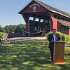 JOHN KLINE | THE GOSHEN NEWS <br /> Matt Crouch, deputy director of the Office of Community and Rural Affairs, speaks during the official ribbon-cutting for the new Ridge Run Trail in Middlebury Saturday afternoon.