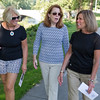 JAY YOUNG | THE GOSHEN NEWS<br /> From left, Peggy Forrest Presser, Janet Evanega and Bobbi Meyers, all of Elkhart, chat as they walk along Beardsley Avenue in Elkhart Wednesday morning while on the Kings of the Hill tour. The 45 minute long walking tour covered approximately half a mile and made 11 stops. Tour guide Steve Gruber spent the tour talking about the well-known families of Elkhart around the turn of the 20th century.