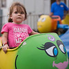 JAY YOUNG | THE GOSHEN NEWS<br /> Two-year-old Reese Risedorph, of Kendallville, looks uncertain as the fish she is sitting in starts to move at the Noble County Fair Tuesday afternoon in Kendallville. The fair continues through Saturday.
