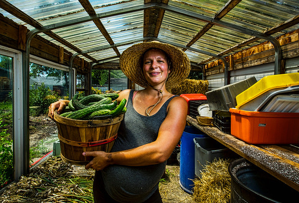 JAY YOUNG | THE GOSHEN NEWS<br /> Nicole Bauman helped transform a vacant lot on Cleveland Street in Elkhart into a thriving urban farm that grows multiple varieties of vegetables.