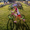 JAY YOUNG | THE GOSHEN NEWS<br /> Sorel Miller, of Goshen, hurries to push her bike out of the transition area during 13th annual Kids' & Teens' Try-Athlon hosted by the Goshen Parks and Recreation Department at Shanklin Park Saturday morning.