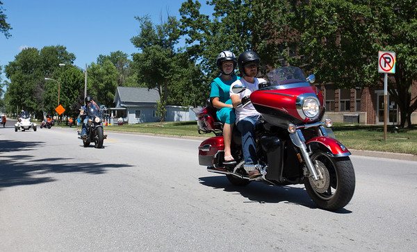 JAY YOUNG | THE GOSHEN NEWS<br /> Motorcycles depart from the Boys and Girls Club of Nappanee as they participate in the seventh annual Cruisin' for the Club motorcycle tour Saturday afternoon in Nappanee. The 70 mile long ride helps raise funds for the club. This past weekend marked the 11th annual Embrace the Pace days in Nappanee.