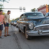 JAY YOUNG | THE GOSHEN NEWS<br /> A group of spectators step out into Main Street to get a closer look at a car during the July First Fridays Cruisin' Reunion Friday evening in downtown Goshen.