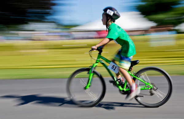 JAY YOUNG   THE GOSHEN NEWS<br /> Garrett Gaby, of Syracuse, zooms past on his bicycle during 13th annual Kids' & Teens' Try-Athlon hosted by the Goshen Parks and Recreation Department at Shanklin Park Saturday morning.