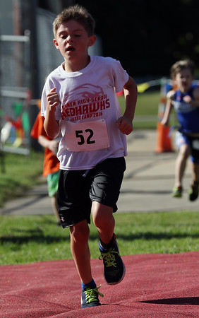 JAY YOUNG | THE GOSHEN NEWS<br /> Parker Dechant, of Goshen, races across the finish line during the 13th annual Kids' & Teens' Try-Athlon hosted by the Goshen Parks and Recreation Department at Shanklin Park Saturday morning.