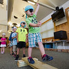 JAY YOUNG | THE GOSHEN NEWS<br /> Three-year-old Ryan Burt, of Goshen, learns what life as a pirate is like as he walks the plank Tuesday morning at the Rieth Interpretative Center during Pirate Camp hosted by the Goshen Parks and Recreation Department. Children attending the camp read stories about pirates, created a treasure map and practiced walking the plank, all while dressing like pirates.
