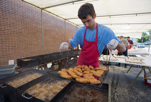 JAY YOUNG   THE GOSHEN NEWS<br /> Brock Beehler, of Nappanee, fries fish in preparation for the annual Original Jonah Fish Fry at the Nappanee Fire Department Saturday evening. About 1,800 pounds of fish were prepared for the 4,000 guests who attended. This past weekend marked the 11th annual Embrace the Pace days in Nappanee.