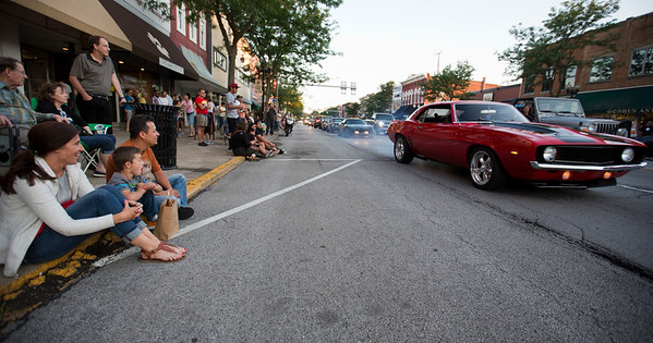 JAY YOUNG | THE GOSHEN NEWS<br /> Six-year-old Jake Figueroa watches a car burn rubber in front of him with his parents, Krissy and Dany, all of New Paris, during the July First Fridays Cruisin' Reunion Friday evening in downtown Goshen.