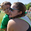JAY YOUNG | THE GOSHEN NEWS<br /> Six-year-old Julian Dominguez, of Nappanee, gets a hug from his mother Britney after completing the 13th annual Kids' & Teens' Try-Athlon hosted by the Goshen Parks and Recreation Department at Shanklin Park Saturday morning.