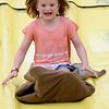 JAY YOUNG | THE GOSHEN NEWS<br /> Seven-year-old Cara Smith, of Avila, lets out a scream as she speeds down the big, yellow slide at the Noble County Fair Tuesday afternoon in Kendallville. The fair continues through Saturday.