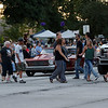 JAY YOUNG | THE GOSHEN NEWS<br /> Pedestrians glance over at old cars that are stopped at a red light as they cross Main Street during the July First Fridays Cruisin' Reunion in downtown Goshen Friday evening.